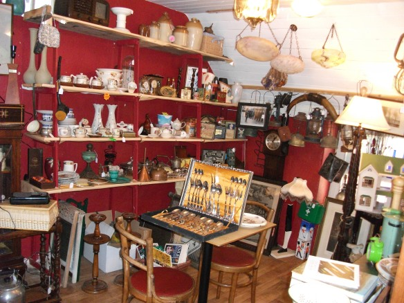 Shelves overflowing with Bric-à-brac