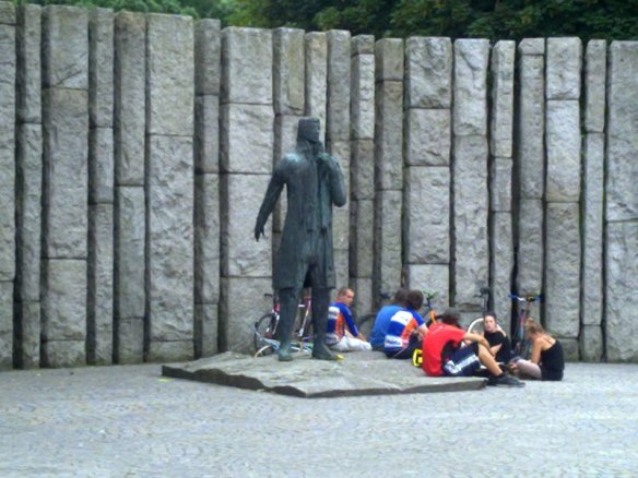 Cyclists resting at the feet of the father of Irish republicanism. I wonder what they are scheming?